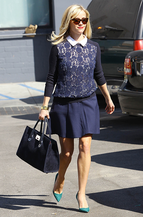 Reese Witherspoon carrying Riley
