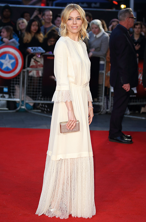 Sienna Miller carrying Box