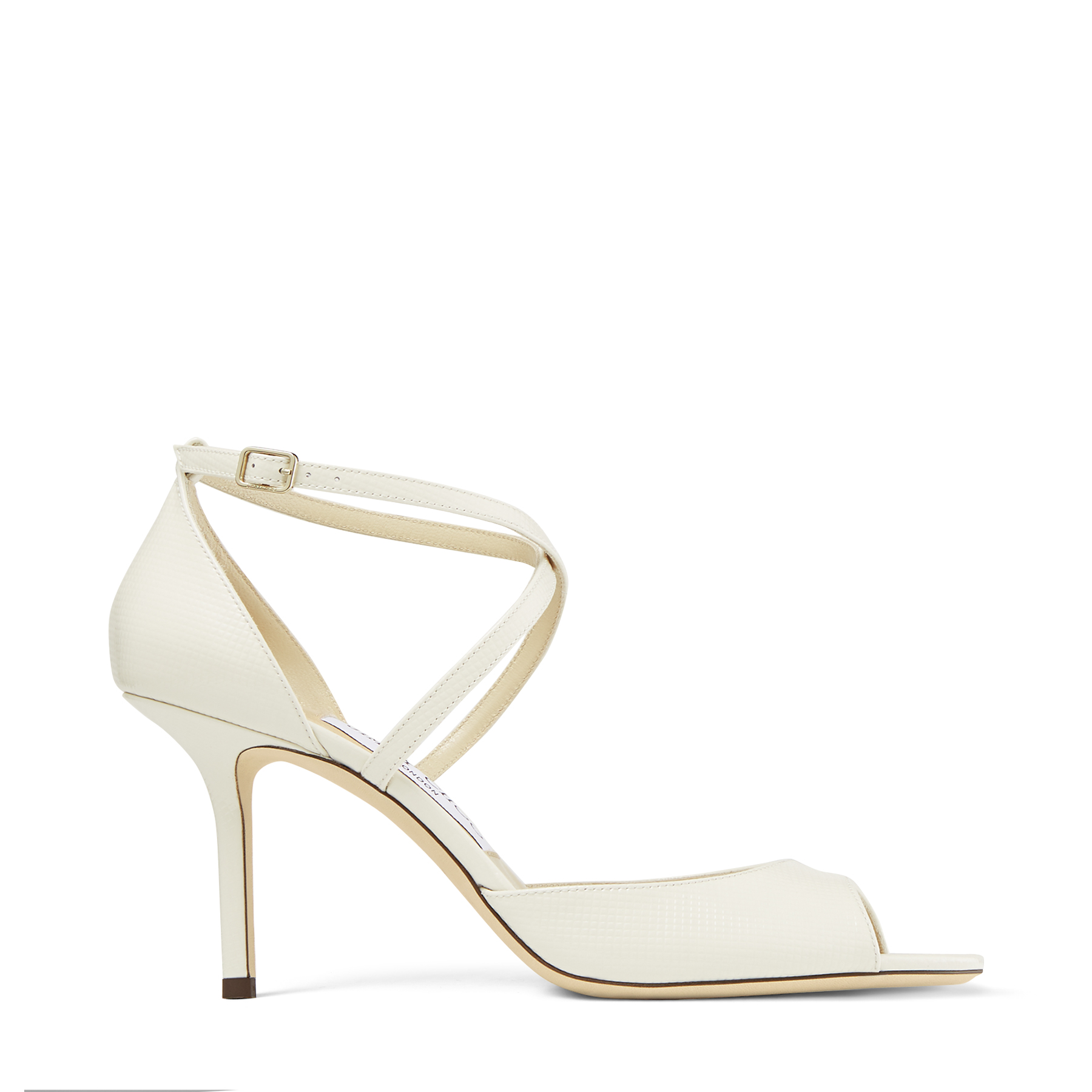 Our latte chevron-embossed patent leather EMSY 85 sandals are a flattering pair that lend a beautifully textured touch to day-to-night looks. This Italian-crafted style is set on a slender stiletto heel, and finished crossover arch straps for leg-lengthening effect.