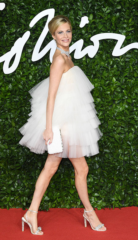 Poppy Delevingne wearing THYRA and carrying ELIPSE