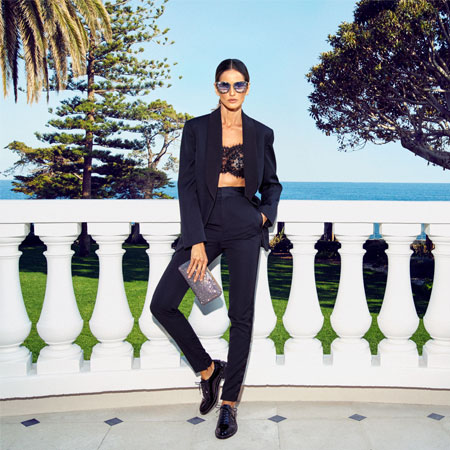 Izabel Goulart wearing REEVE and LIZZY and carrying ELLIPSE