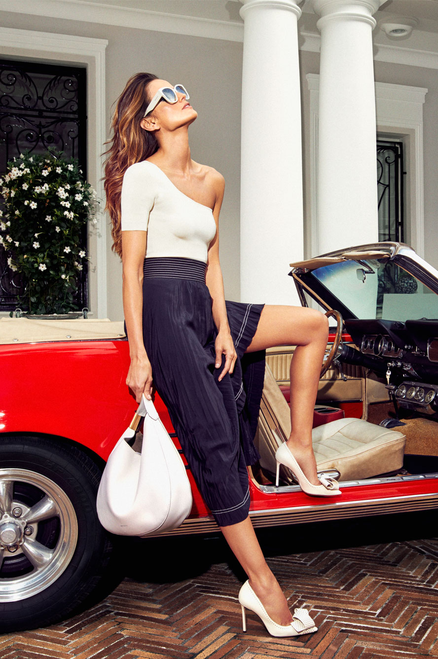 Izabel Goulart wearing TEGAN and ROXIE and carrying STEVIE